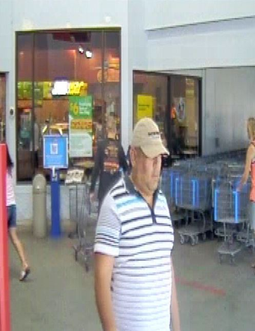 a photo of an identity theft suspect leaving Wal-Mart