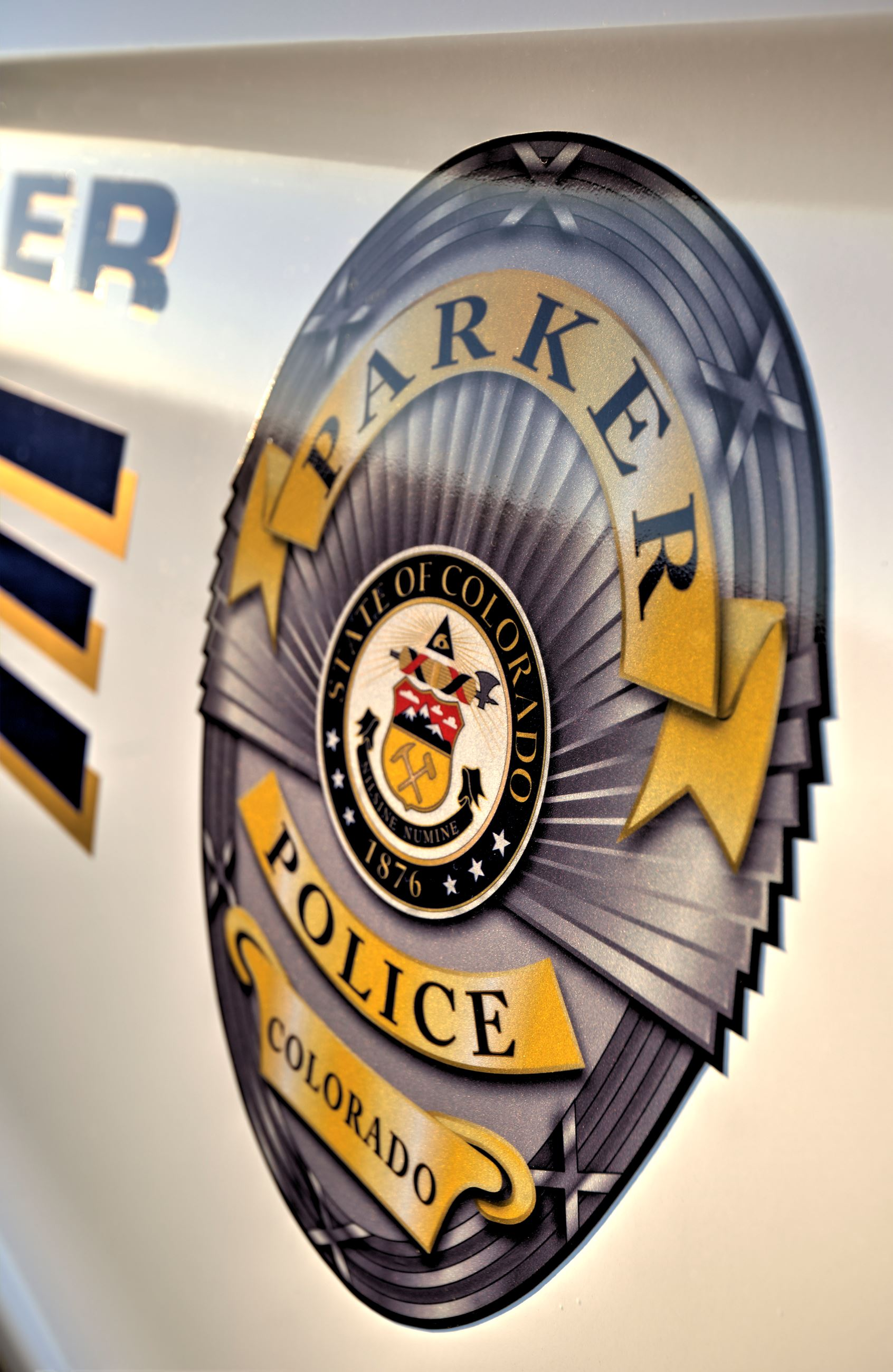 Parker Police Badge on the side of a police car