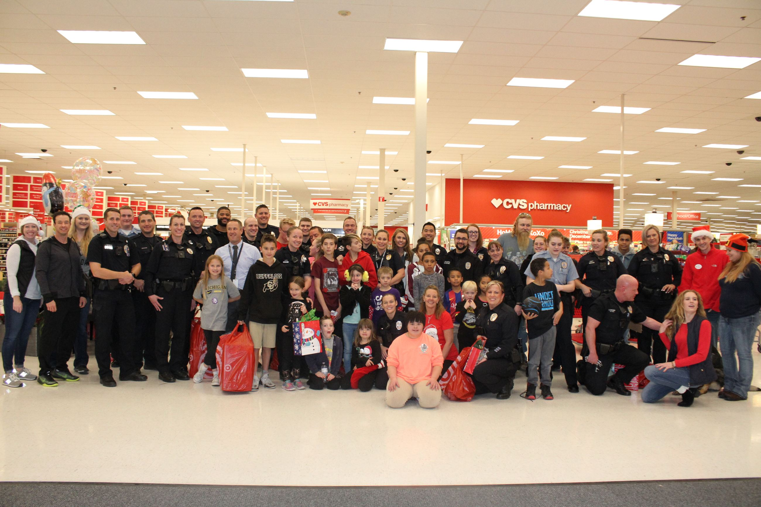 Picture of Officers and kids at target for shop with a cop